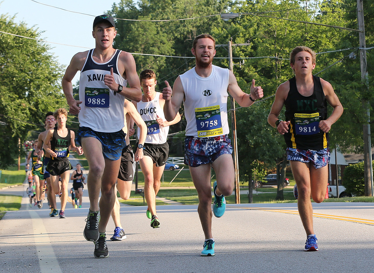 AARON JOSEFCZYK / GAZETTE Austin Neura gives the thumbs up as he runs along fellow Medina residents Kevin Menyes (left) and Jake Wickert (right), during a 5-kilometer race at the Medina Twin Sizzler event held Tuesday.