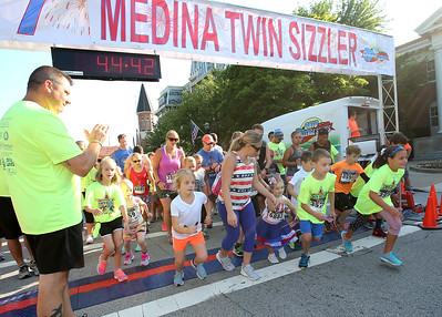 AARON JOSEFCZYK / GAZETTE Kids take off for the start of a fun run during the Medina Twin Sizzler event held Tuesday.