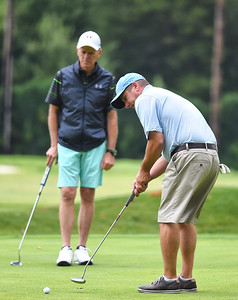 KRISTIN BAUER | CHRONICLE Chris Burdon putts during the UH Elyria Medical Center 16th Annual Foundation Golf Classic outing held at Elyria Country Club on Monday afternoon, July 24.
