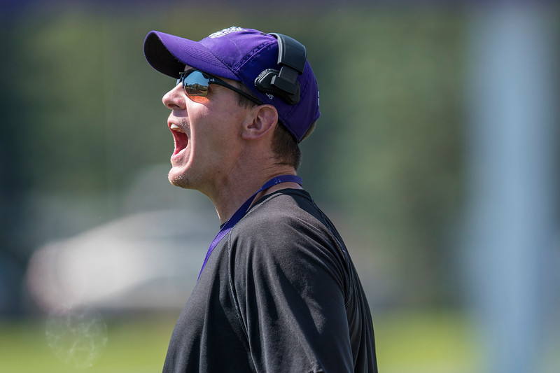 Weber State coach Jay Hill  yells at players to get them in position during the football scrimmage, at the Stewart Stadium in Ogden on Thursday August 17, 2017.