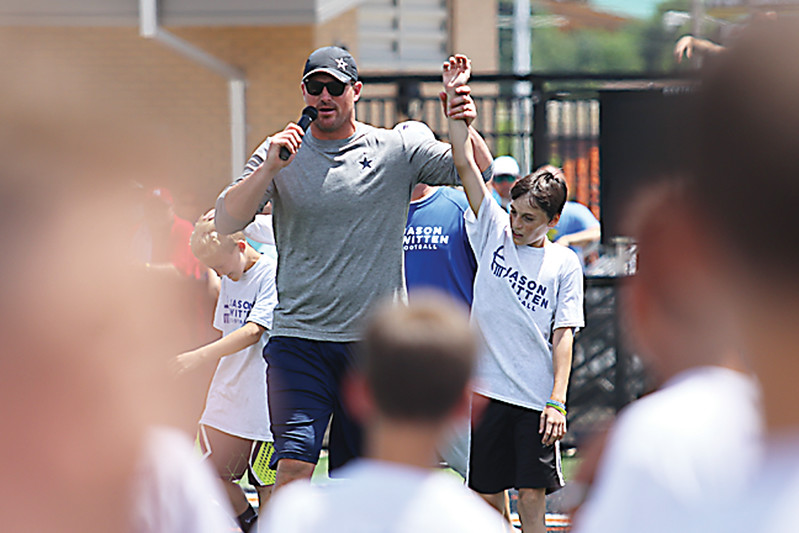 Star Photo/Bryce Phillips <br /> Jason Witten announces the winner of the fastest camper contest.