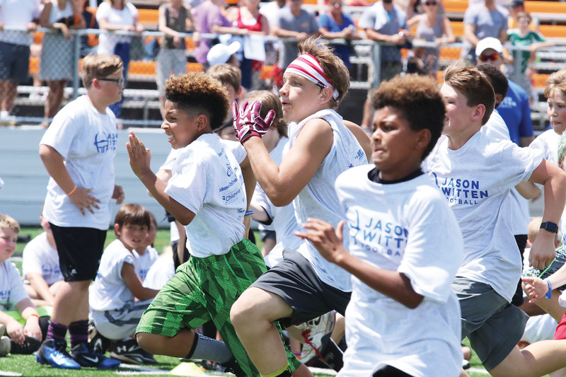 Star Photo/Bryce Phillips <br /> Campers compete to see who is the fastest during Saturday's Jason Witten Football Camp at Citizens Bank Stadium.