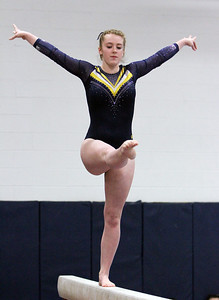 ANNA NORRIS/CHRONICLE North Ridgeville's Sarah Kegg competes on the balance beam in the Northeast Ohio Sectional gymnastics meet Sunday afternoon at West Geauga High School.