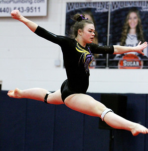 ANNA NORRIS/CHRONICLE Avon's Kamryn Sharer performs her floor routine at the Northeast Ohio sectional gymnastics meet Sunday afternoon at West Geauga High School.
