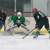 Tommy Car's player goes one on one with Quack Attack's goalie Matt Beida