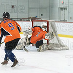 Indian's goalie Steve DaSilva grabs the puck