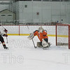 After stealing the puck Mike Abbott goes high glove for the goal