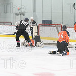 After a shot block by the Indian's goalie Greg Kissel jams home the rebound for a goal