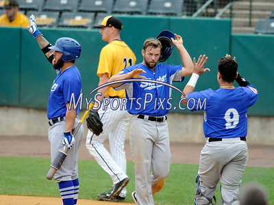 8/29/2017 Mike Orazzi | Staff The Sugar Land Skeeters' Dickie Thon (18) after scoring the winning run during Tuesday's game with the New Britain Bees.