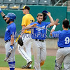 8/29/2017 Mike Orazzi | Staff<br /> The Sugar Land Skeeters' Dickie Thon (18) after scoring the winning run during Tuesday's game with the New Britain Bees.