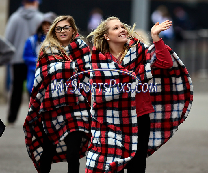 4/5/2017 Mike Orazzi | Staff<br /> Gabriela Soli and Jillian Arens while bundled up while watching an early season baseball game between Bristol Eastern and Plainville at Plainville High School Wednesday afternoon.