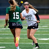 4/26/2017 Mike Orazzi | Staff<br /> Bristol Coop Girls Lacrosse Ashley Macdonald (11) and Northwest Catholic's Madison Cote (15) at Bristol Eastern.