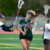 4/26/2017 Mike Orazzi | Staff<br /> Bristol lacrosse's Gabriele Abramczyk (8) and Alyson Policarpio (4) with Northwest Catholic's Meredith Oakley (6) at Bristol Eastern.