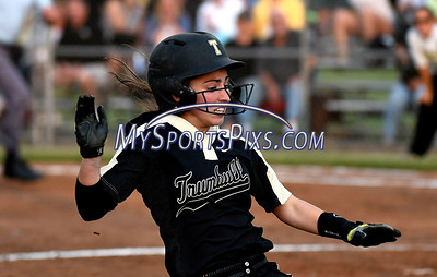 6/10/2017 Mike Orazzi | Staff Trumbull's Maggie Coffin (12) slides into third base during the Class LL softball final at West Haven High School Saturday night.