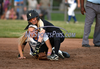 6/10/2017 Mike Orazzi | Staff Southington's Chrissy Marotto (22) and Trumbull's Maggie Coffin (12) at second base in the Class LL softball final at West Haven High School Saturday night.