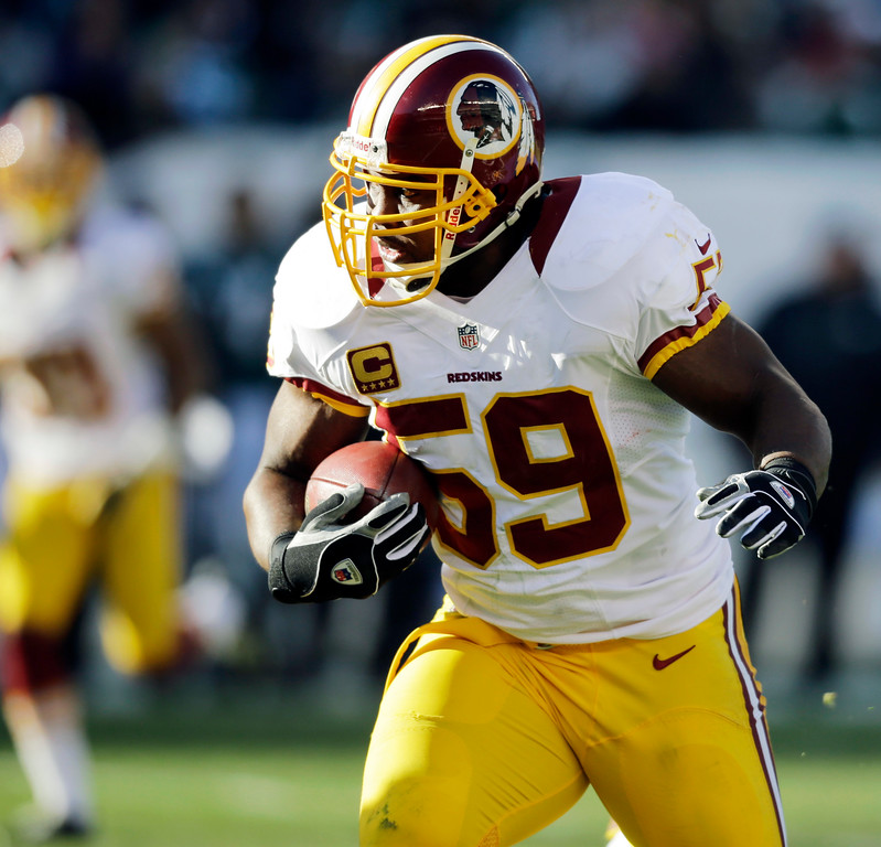 . Washington Redskins\' London Fletcher returns an interception in the first half of an NFL football game against the Philadelphia Eagles, Sunday, Dec. 23, 2012, in Philadelphia. (AP Photo/Mel Evans)