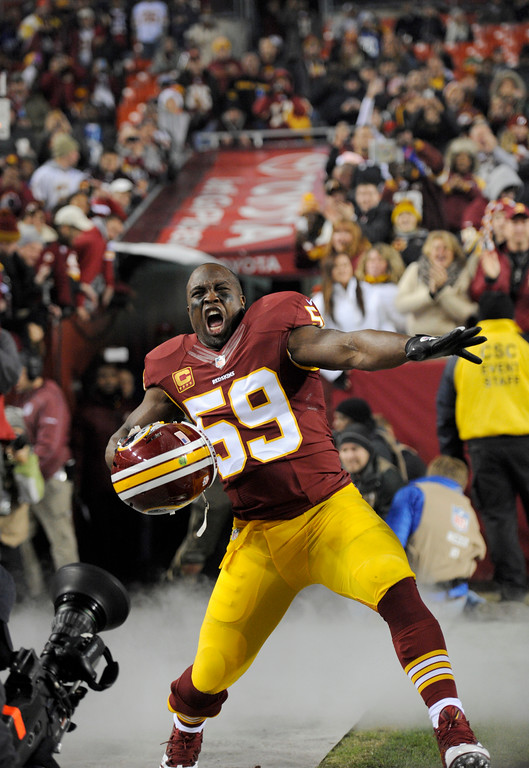 . Washington Redskins inside linebacker London Fletcher (59) reacts during player introductions before an NFL football game against the New York Giants, Sunday, Dec. 1, 2013, in Landover, Md. (AP Photo/Nick Wass)