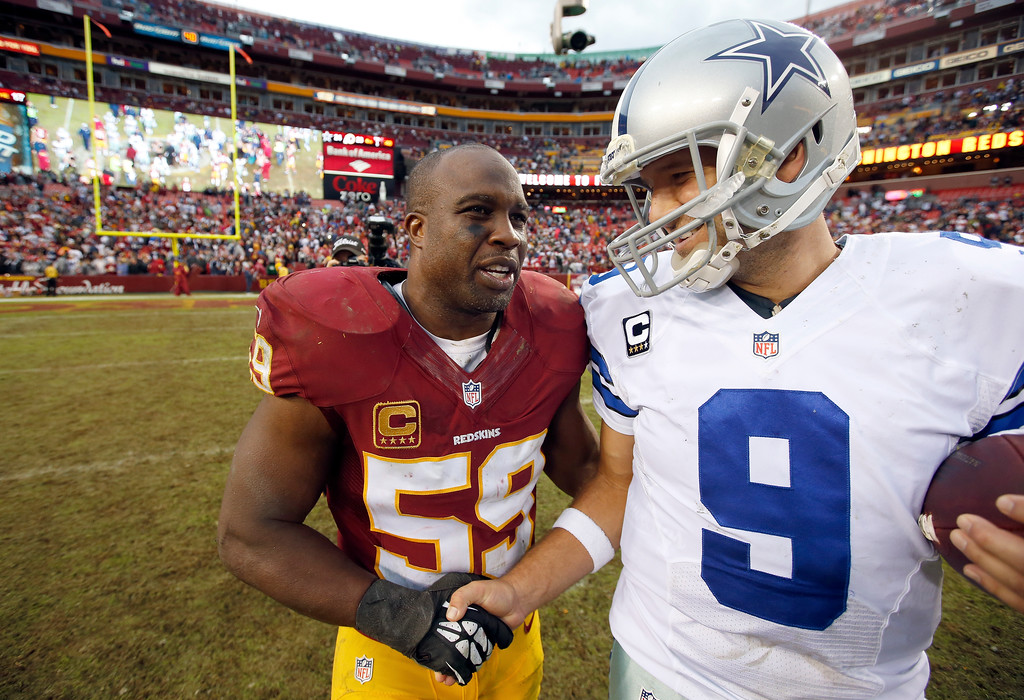 . Washington Redskins inside linebacker London Fletcher shakes hands with Dallas Cowboys quarterback Tony Romo after an NFL football game in Landover, Md., Sunday, Dec. 22, 2013. The Cowboys defeated the Redskins 24-23. (AP Photo/Alex Brandon)