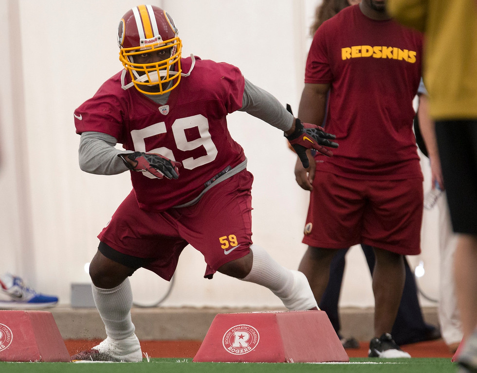 . Washington Redskins\' London Fletcher works out during a NFL football minicamp at Redskins Park, Tuesday, June 11, 2013, in Ashburn, Va. (AP Photo/Carolyn Kaster)