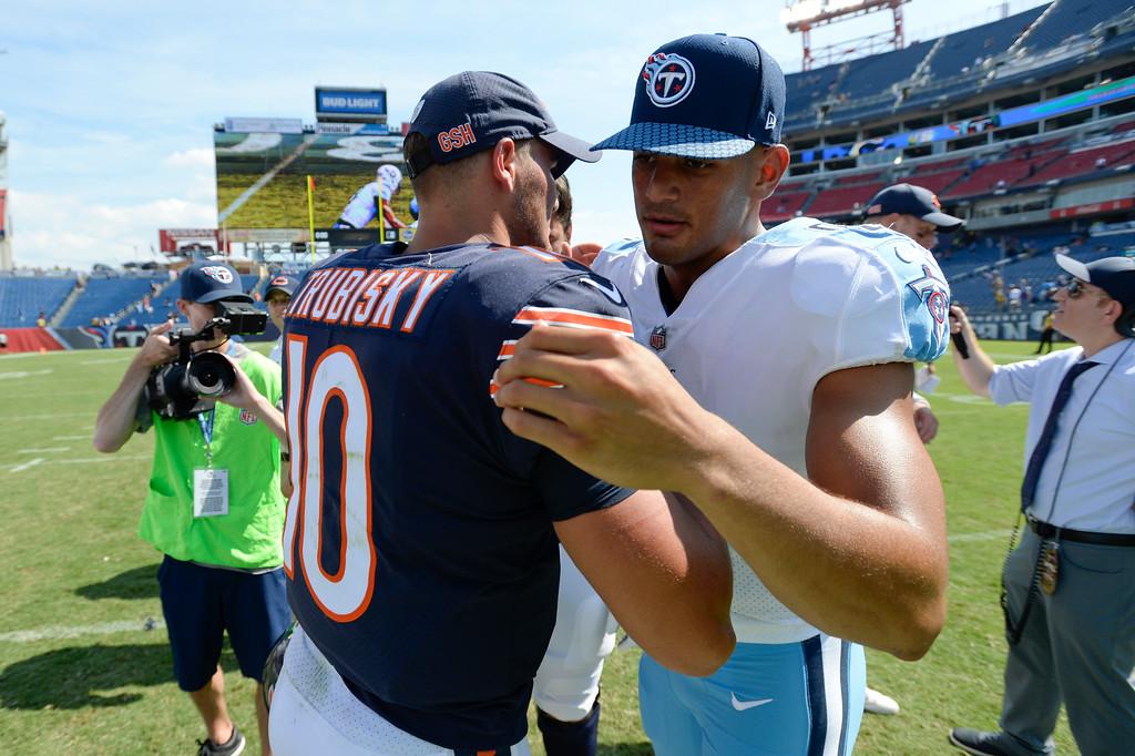 . Chicago Bears quarterback Mitchell Trubisky (10) greets Tennessee Titans quarterback Marcus Mariota, right, after an NFL football preseason game Sunday, Aug. 27, 2017, in Nashville, Tenn. The Bears won 19-7. (AP Photo/Mark Zaleski)