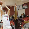 Austin Beaghan slides in behind Colin Williams for the layup