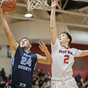 Trey Knight gets by Austin Beaghan for a layup