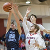 Tanner Conley loses control of the ball on a shot with pressure from Austin Beaghan and Collin Wigley
