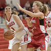 Ali Berry looks at a shot under the basket against Emma Grubb