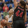 NaKaila Gray looks up at the basket as Naomi Gibson prepares to block