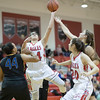 Naomi Gibson powers her way up for a shot indert the basket
