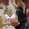 Haley Cave takes a look at a shot under the basket against Tycara Scott