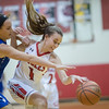 Ali Berry and Sophia Adams fight for a loose ball