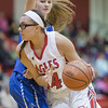 Naomi Gibson works her way to the basket