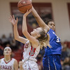 Meredith Dean sails by Hannah Johnson for a layup