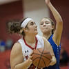Catherine Orndorff turns around by Abigail Tanner for a shot under the basket