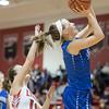 Brooke Vetter slides in under the basket for a shot