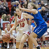 Erin Clayton tries to work the ball in by Stephanie Ouderkirk