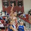Alexis Baugher goes in for the layup drawing the fowl from Mary-Ruth Shifflett