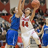 Naomi Gibson goes up for a shot against Casey Irvine