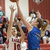 Casey Irvine blocks a shot from Erin Clayton