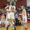 Naomi Gibson hugs Erin Clayton after she took a charge from SHS