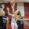 Meredith Dean goes in for a layup against Sara Streett (22) and Jailyn Dellinger (23)