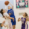 Brooke Vetter goes up for a shot over Stonewall's Sarah Street