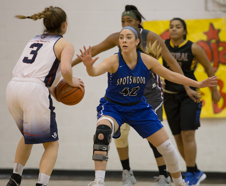 Casey Irvine guards Harrisonburg's Komara Constance.