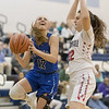 Meredith Vetter goes for a layup against Stonewall's Sarah Street
