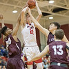 Dalton Jefferson powers his way up to a shot amoung a trio of Luray players