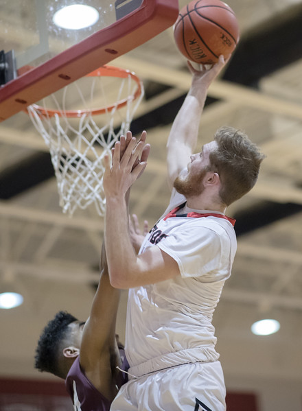 Collin Wigley puts the ball up under the basket