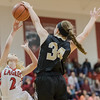 Brittney Hanger gets a hand on a layup from Meredith Dean