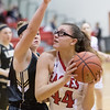 Naomi Gibson takes a look at a shot under the basket