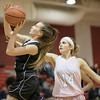 Ali Berry sails by Lauren Williams for a layup